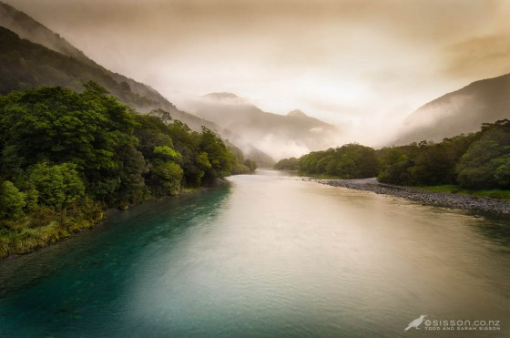 misty evening light over the haast river, near Haast Pass