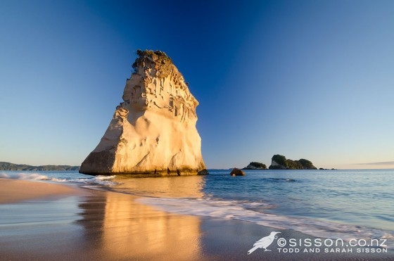 Photo of Sail Rock at dawn.  Cathedral Cove, Coromandel Peninsula New Zealand