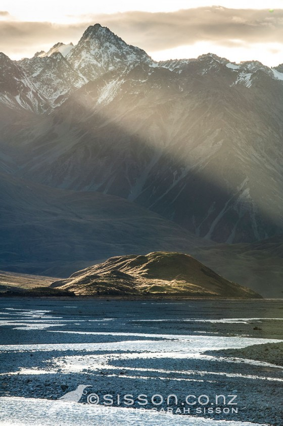 Sunbeams over the Two Thumb range, Rangitata valley. Canterbury New Zealand.  Landscape photography by Todd Sisson