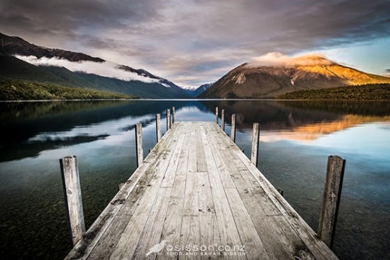 First light plays out on Mount Robert - viewed from the jetty at Lake Rotoiti, Nelson Lakes.  New Zealand landscape photography by Todd Sisson.